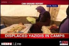 US and Iraqi airstrikes target; thousands of Yazidis flee ISIS forces