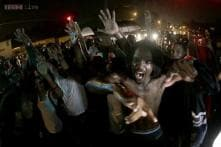 Curfew re-imposed in Missouri city where black teen shot by police