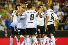 Valencia romp to 3-0 win over 10-man Malaga