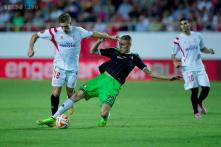 Sevilla sparkle as Europa League returns with goal glut