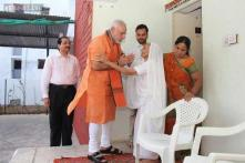 Watch: PM Narendra Modi's mother gives him laddoo, Rs 5000 on his 64th birthday