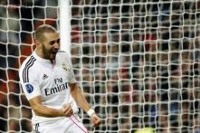 Real Madrid beat Liverpool 1-0 to reach knockout round