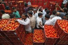 India, isolated, toughs it out in WTO food-stockpiling row
