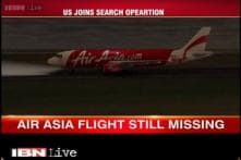 Search for missing AirAsia plane expands