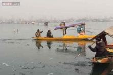 In pics: Shikaras struggle to move in frozen Dal lake in Srinagar