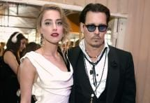 Johnny Depp walks down the aisle with Amber Heard