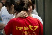 Families mark MH370 anniversary with vow to never give up