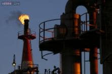 Oil prices edge down from 2015-highs, but set for weekly gain