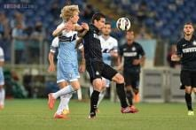 Champions League race wide open as nine-man Lazio lose in Serie A