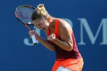 US Open: Halep beats heat, injury and Lisicki to reach quarters