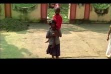 Jharkhand: 11-year-old carried her ill brother on her shoulders for 8 kms to reach hospital