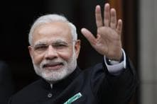 PM Modi signs national flag, sparks controversy