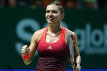 Simona Halep routs Flavia Pennetta in opening match at WTA Finals