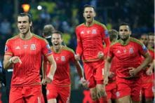 Wales lose but qualify for Euro 2016 with Belgium and Italy