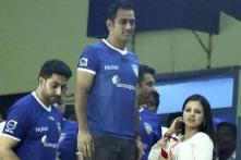 Images: Abhishek Bachchan in 'lungi', enjoys ISL match with Mr. & Mrs Dhoni