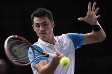 Dominic Thiem, Bernard Tomic advance at Paris Masters