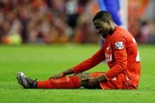 Liverpool's Divock Origi out for a month after knee surgery