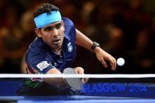 Setback for men, women advance at World Table Tennis Championships