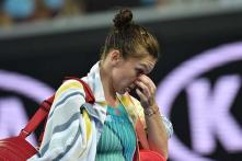 Second seed Simona Halep dumped out by qualifier Zhang Shuai