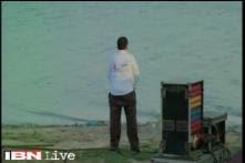 UP babu caught on cam peeing on banks of Triveni Sangam