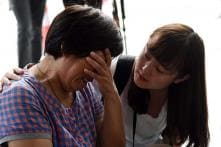Families of 12 passengers on flight MH370 file lawsuits