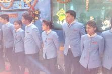 Train hostesses and stewards: The cheerful women and men in blue