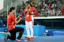 Chinese Diver Wins Silver Medal; Boyfriend Goes up on Stage and Proposes