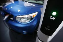 Top Automakers Fund Charging Sites to Boost Electric-Car Demand