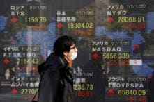 Asian Shares Rattled by Donald Trump Policy Worries, Dollar Soft