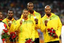 Life Goes On for 'Disappointed' Usain Bolt After Losing Medal