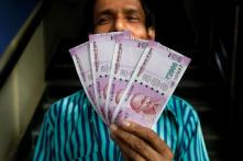 Rupee Crashes to 19-Month Low on Oil Scare, Trade War Worries