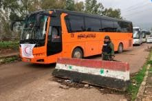 Evacuations of Opposition Fighters Resume in Syria's Homs