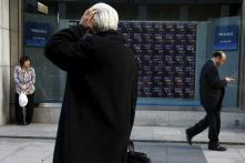 Asian Shares Hit Two-year High After Fed Signals Gradual Tightening