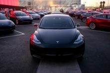 Tesla Shares Jump on Model 3 Numbers, CEO Elon Musk Deal