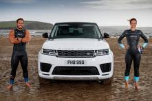 Range Rover Sport PHEV Races With Pro Swimmers in Sea [Video]