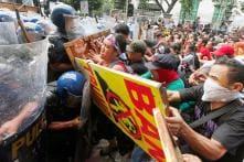 Anti-Trump Protest in Manila: Several Cops & Protesters Injured