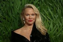 'I Love Him': Pamela Anderson Gets Emotional After Meeting Julian Assange in Prison