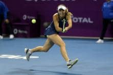 Irritated World Number 1 Caroline Wozniacki Through to Qatar Quarters