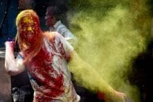 Day in Photos - Mar 1: Holi Festival; PM Modi Meets Jordanian King; SA vs Aus Test Cricket