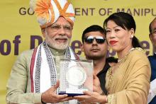 Day in Photos - Mar 16: PM Modi in Imphal; Daler Mehndi Convicted; Winter Paralympics