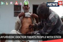 OMG : Man cures people just by touching with this 'Magical Stick'!