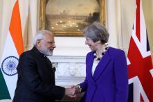 Day in Photos - Apr 18: PM Modi in London; ATM Cash Crunch; Congress Protest