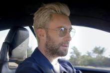 Maroon 5 Lead Singer Adam Levine Drives Porsche Mission E Sportscar [Video]