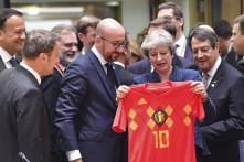 Belgian PM Surprises UK's May With World Cup Shirt