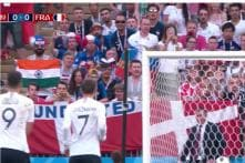 Who is this Man Sitting With an Indian Flag While Denmark and France Played a World Cup Game?