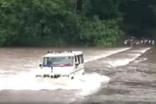 Watch Brave Cops Drive SUV Across River to Rescue Stranded Family in Kerala [Video]