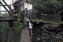 Watch: Children Use Ladder to Go to School After Bridge Breaks Down