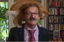 Polish Historian Didn't 'Paws' After a Cat Decided To Climb On His Head During an Interview