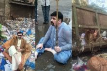 This Karachi Politician is Literally Going Down the Drain to Seek Votes