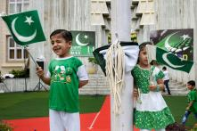 Day in Photos - August 14: Pakistan's Independence Day; Italy Highway Bridge Collapse